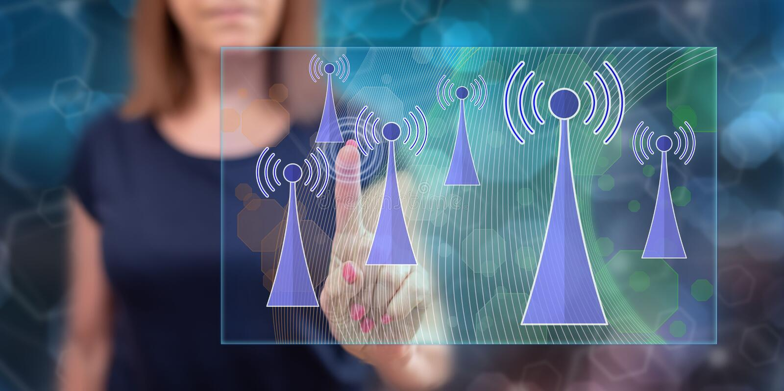 Woman touching a wifi signal concept stock photography