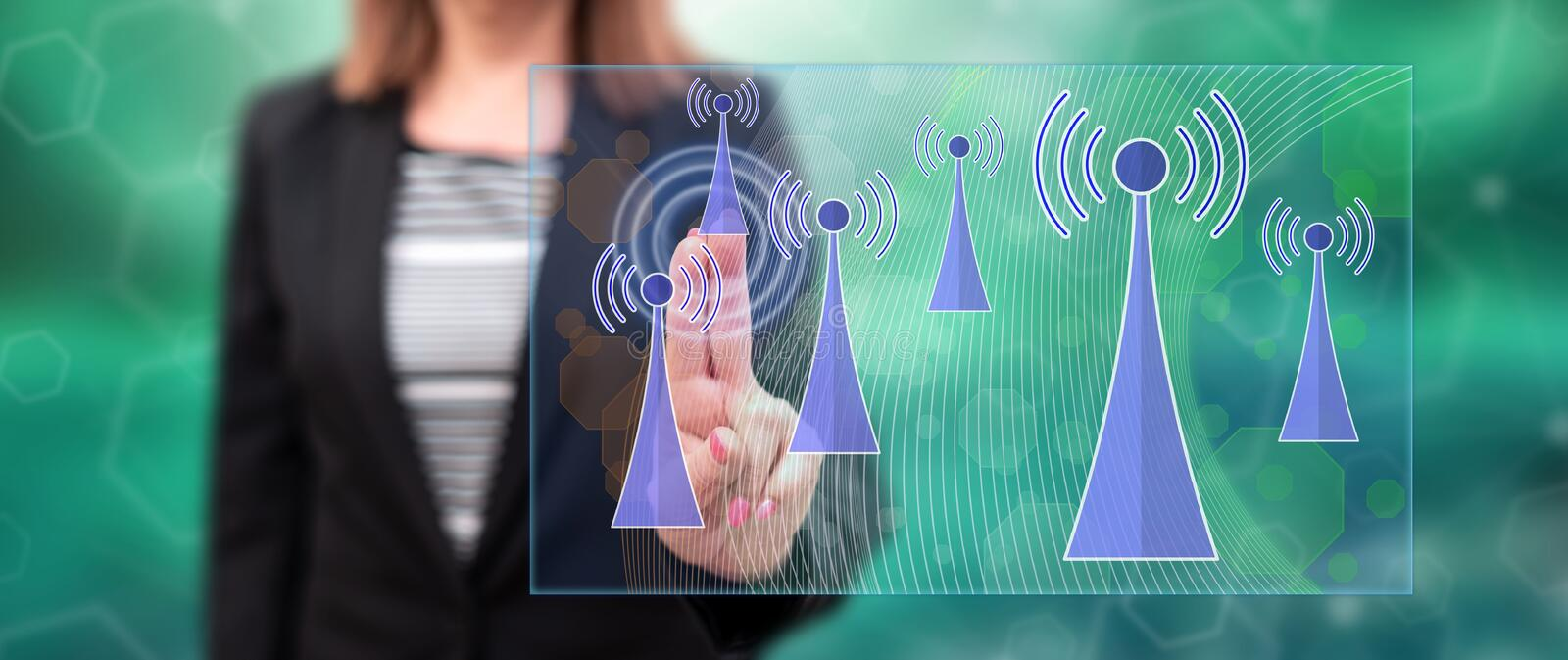 Woman touching a wifi signal concept royalty free stock images