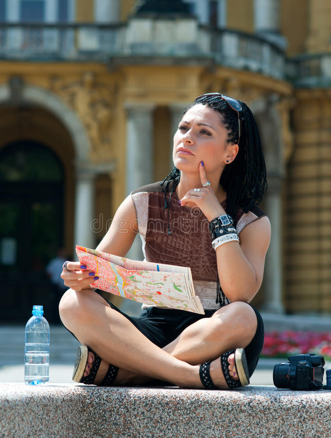 Woman tourist. Looking at map and thinking in old city site stock photos
