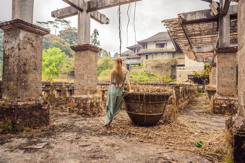 Woman tourist in abandoned and mysterious hotel in Bedugul. Indonesia, Bali Island. Bali Travel Concept stock photography