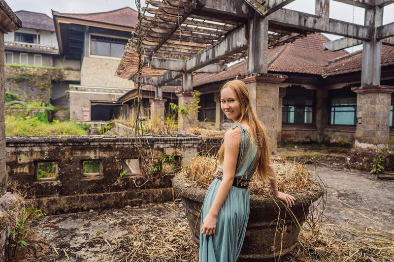 Woman tourist in abandoned and mysterious hotel in Bedugul. Indonesia, Bali Island. Bali Travel Concept stock images