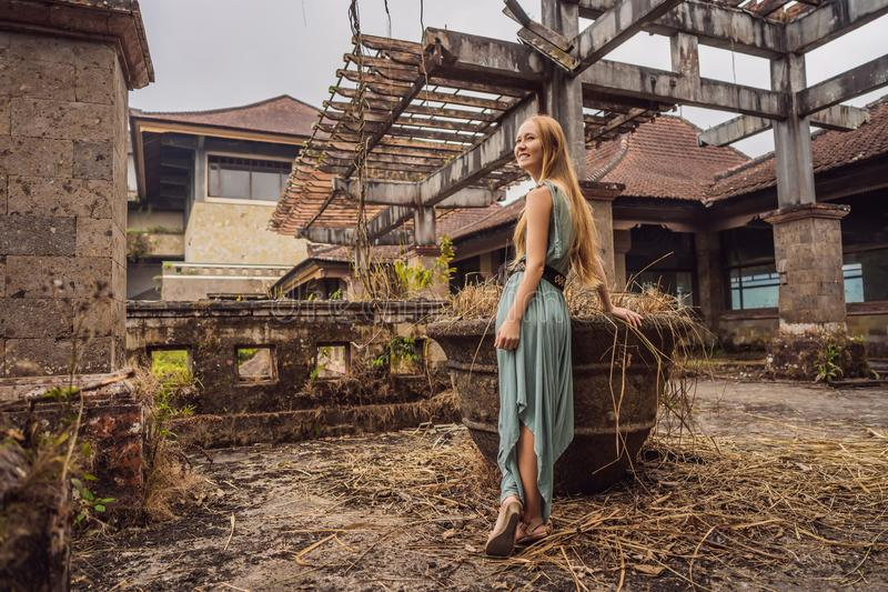 Woman tourist in abandoned and mysterious hotel in Bedugul. Indonesia, Bali Island. Bali Travel Concept royalty free stock photo