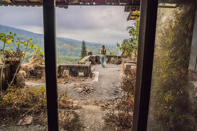 Woman tourist in abandoned and mysterious hotel in Bedugul. Indonesia, Bali Island. Bali Travel Concept royalty free stock photos
