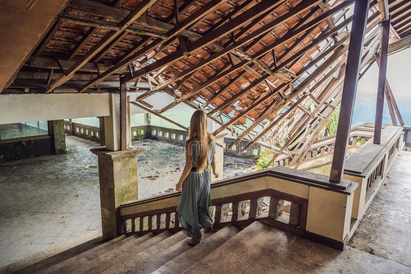 Woman tourist in abandoned and mysterious hotel in Bedugul. Indonesia, Bali Island. Bali Travel Concept stock photos