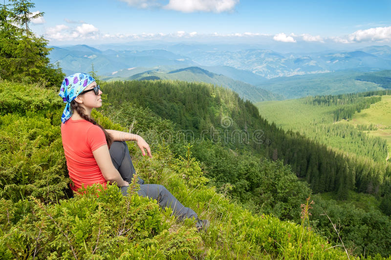 Woman tourist admiring views of the mountains royalty free stock photography