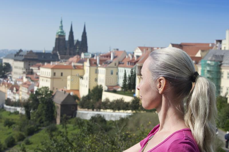 The woman the tourist on a beautiful background of the old city, Prague royalty free stock photo
