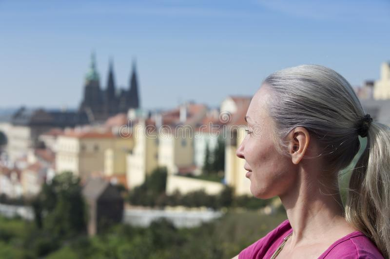 The woman the tourist on a beautiful background of the old city, Prague royalty free stock images