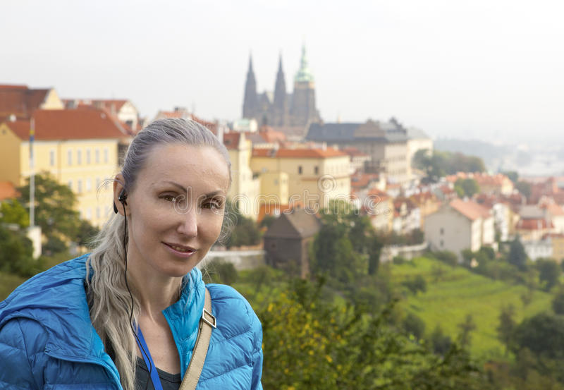 The woman the tourist on a beautiful background of the old city, Prague stock images