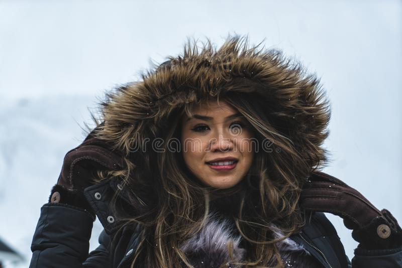 Woman posing in the mountains of the Lofoten Islands. Reine, Norway royalty free stock images