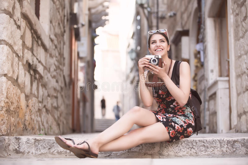 Woman tourist capturing memories.Young woman tourist,nomad,backpacker.Beautiful woman traveling alone.Korcula, Dubrovnik,Croatia t. Our.Outdoor summer smiling royalty free stock images