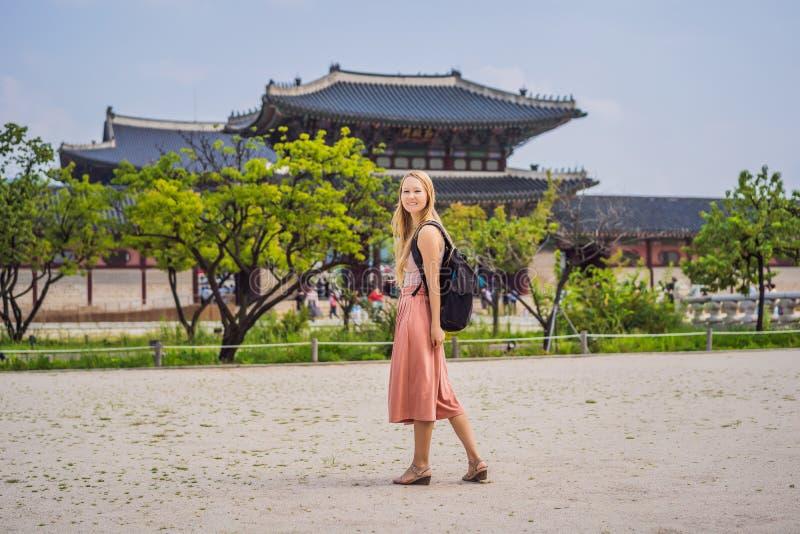 Woman tourist in korea. Gyeongbokgung Palace grounds in Seoul, South Korea. Travel to Korea concept stock images