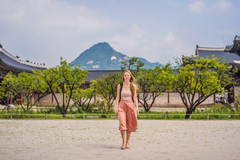 Woman tourist in korea. Gyeongbokgung Palace grounds in Seoul, South Korea. Travel to Korea concept stock photos
