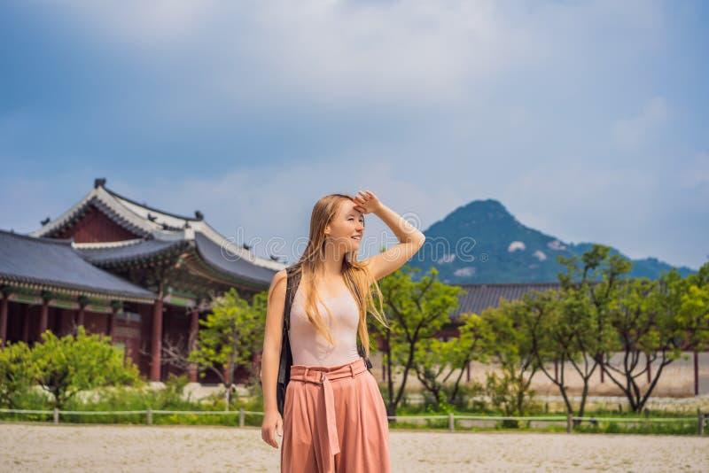 Woman tourist in korea. Gyeongbokgung Palace grounds in Seoul, South Korea. Travel to Korea concept stock photo