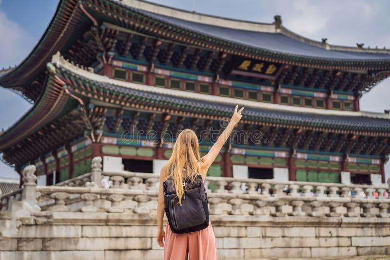 Woman tourist in korea. Gyeongbokgung Palace grounds in Seoul, South Korea. Travel to Korea concept royalty free stock photo