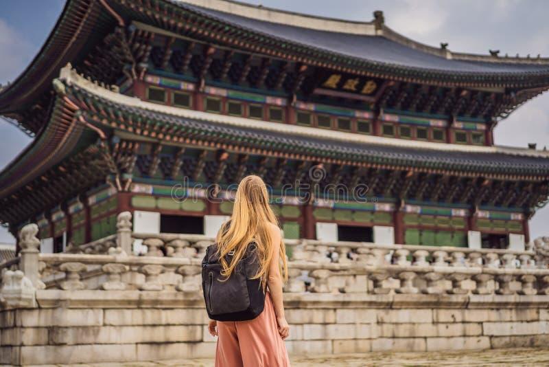 Woman tourist in korea. Gyeongbokgung Palace grounds in Seoul, South Korea. Travel to Korea concept royalty free stock image