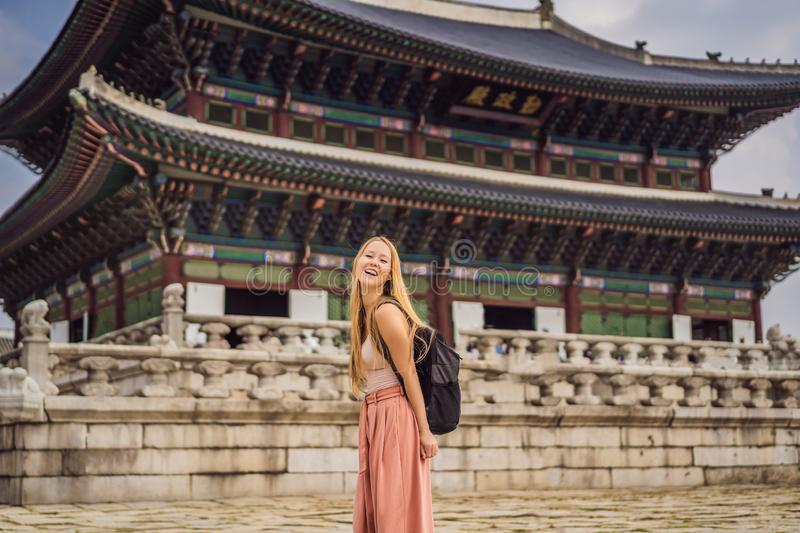 Woman tourist in korea. Gyeongbokgung Palace grounds in Seoul, South Korea. Travel to Korea concept royalty free stock images
