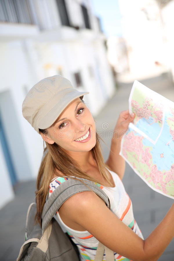 Free Woman Tourist Looking At Map Stock Photos - 64887743