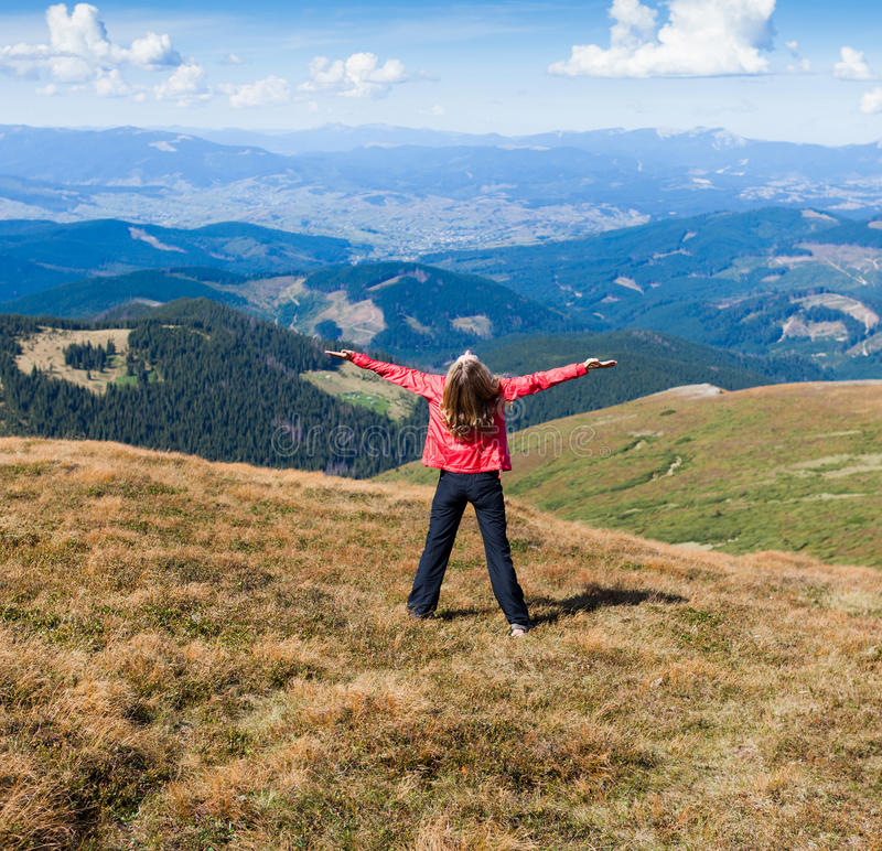Woman Tourist On The Mountain With Raised Hands Feeling Success Stock Photography