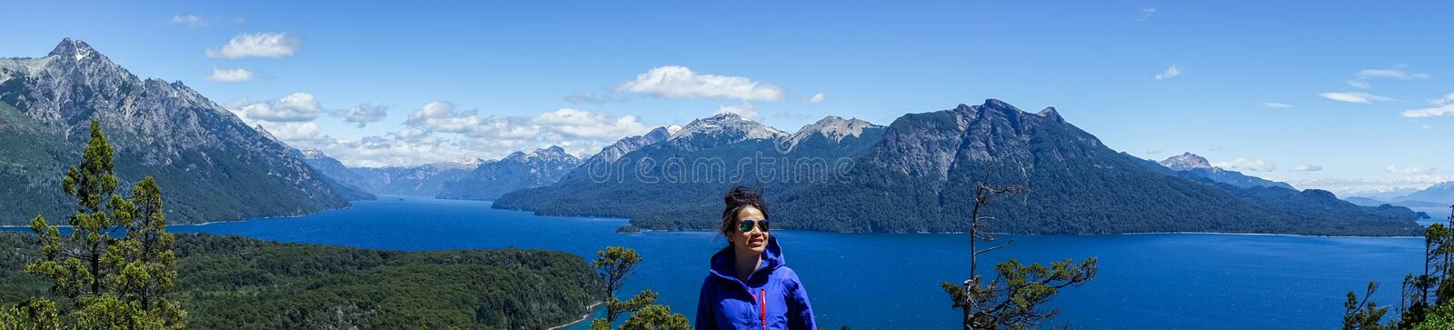 A woman tourist in the mountains and lakes of San Carlos de Bariloche, Argentina. Vistas of San Carlos de Bariloche, Argentina South America. Patagonia stock photography