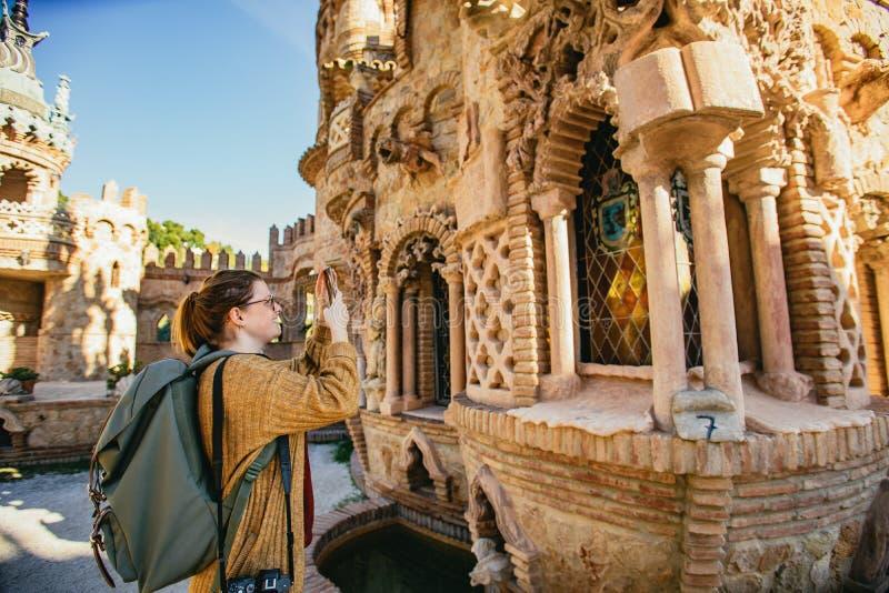 Woman tourist photographing Castillo de Colomares stock image