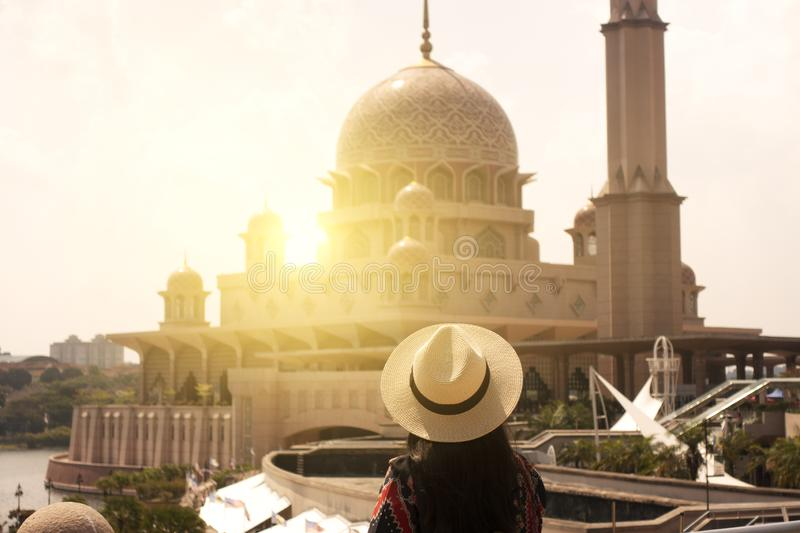 Woman tourist is sightseeing Putrajaya Mosque during travel royalty free stock images