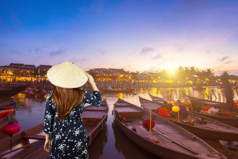 Woman tourist is sightseeing and travel in Hoi An royalty free stock image