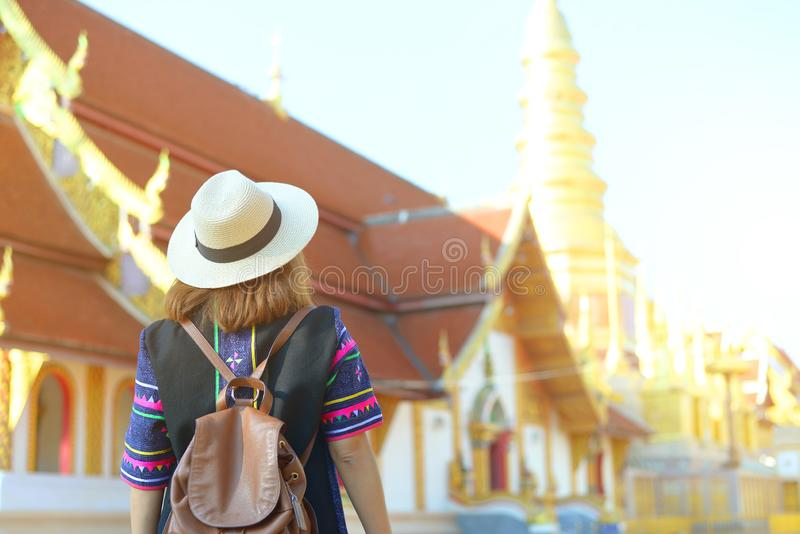 Woman tourist is sightseeing at Wat Phra Bat Huay Tom in Lamphun province stock photography
