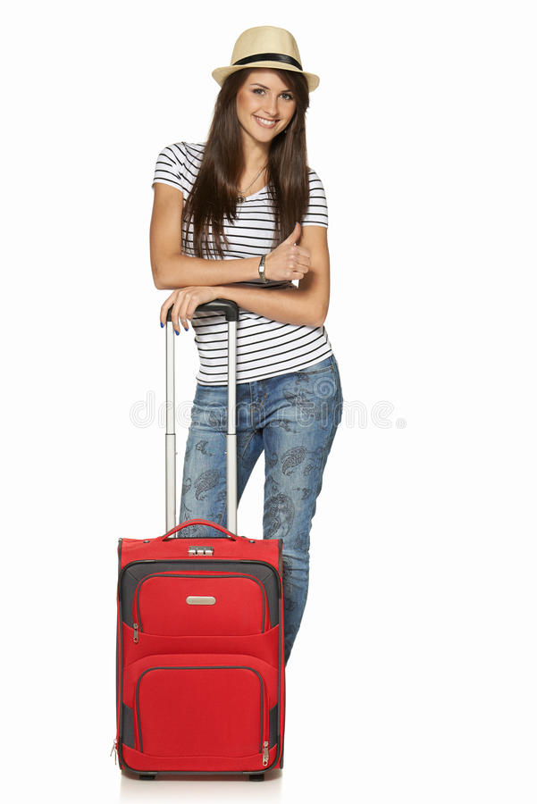 Woman tourist with suitcase stock photo