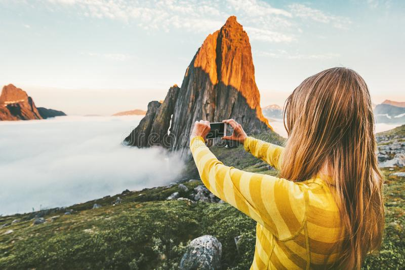Woman tourist taking photo by smartphone royalty free stock images