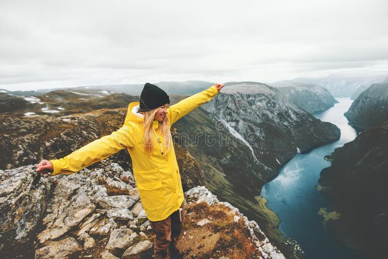 Woman tourist traveling in Norway mountains happy raised hands stock photo