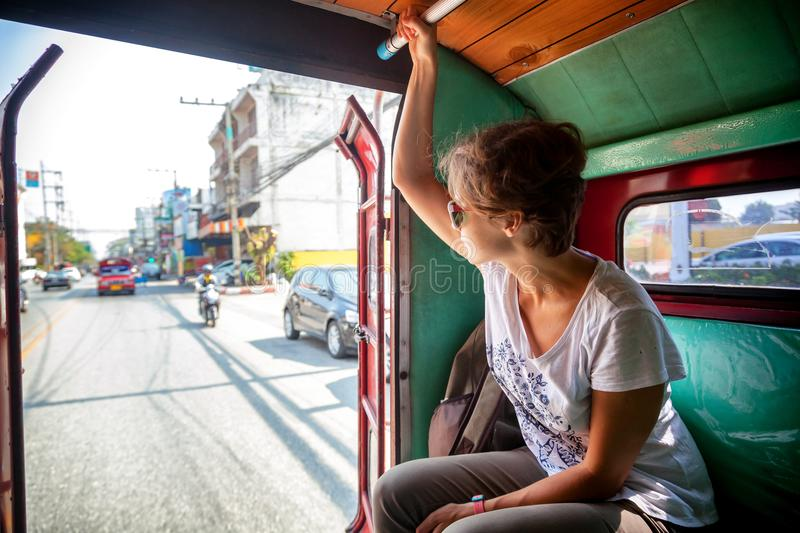 Woman tourist traveling to the Thai public transport, Songteo royalty free stock images
