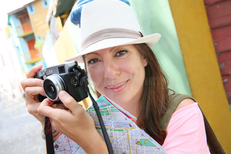 Woman tourist travelling and taking photos in La Boca. Tourist taking picutre in La Boca neighborhood, Buenos Aires royalty free stock images