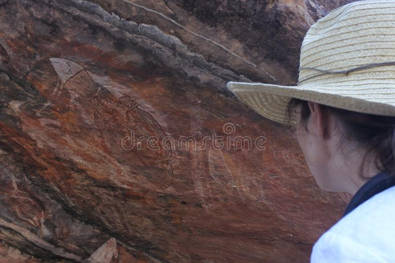 Woman tourist visit at Ubirr rock art site in Kakadu National Park Northern Territory of Austr royalty free stock photos