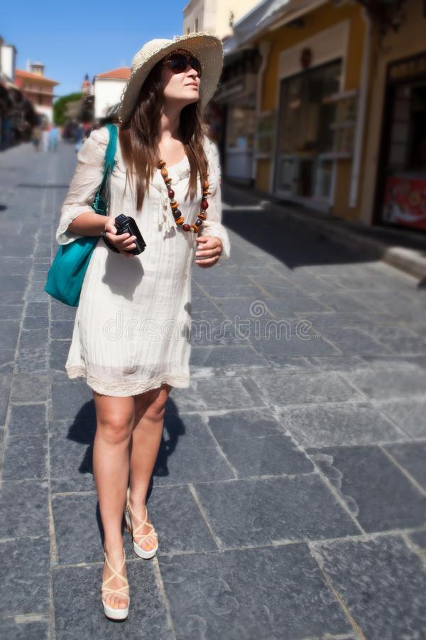 Woman Tourist Walking In The City Street Royalty Free Stock Image