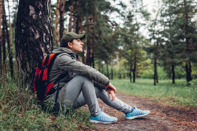 Woman tourist walking in spring forest. Close up of shoes. Traveling and tourism concept royalty free stock photography