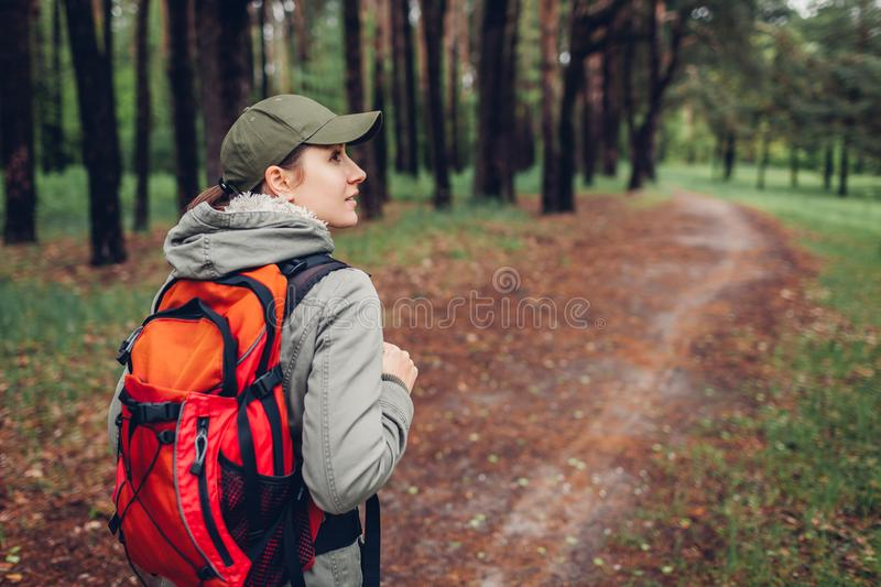 Woman tourist walking in spring forest. Close up of shoes. Traveling and tourism concept stock images