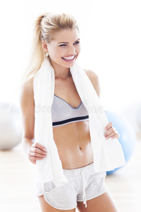 Woman with towel at gym royalty free stock photo