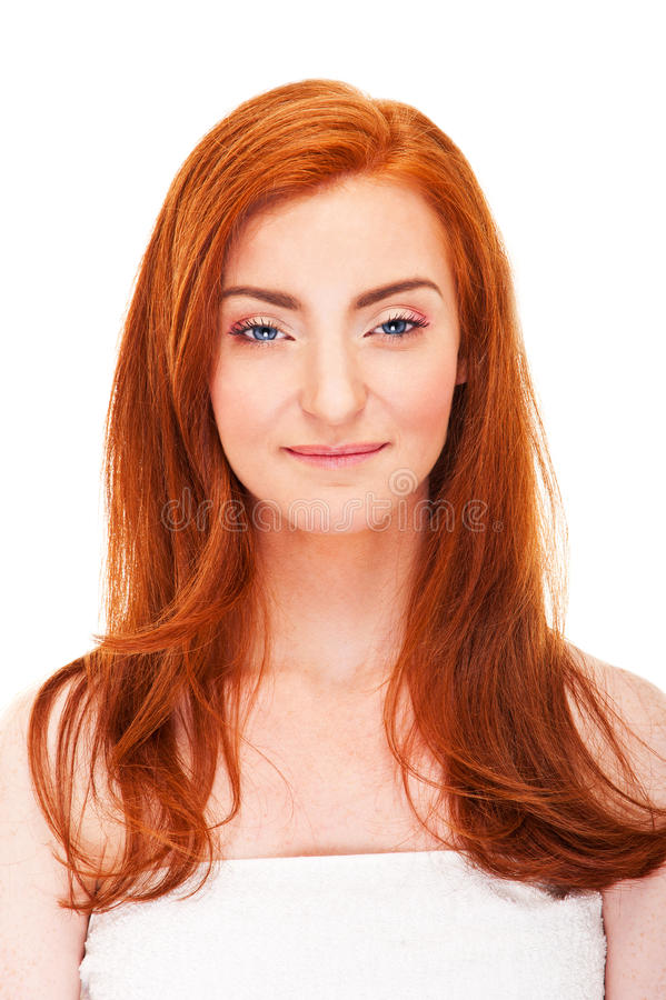 Woman in towel with red hair stock photography