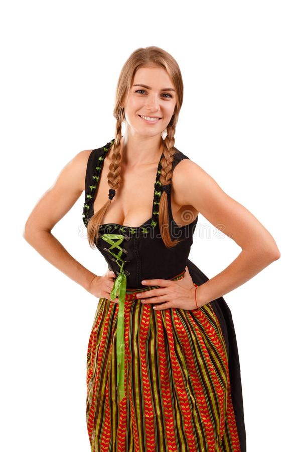 Woman in traditional bavarian dress. Isolated on white. German or Bavarian waitress with her hair in pigtails wearing a traditional dirndl. Oktoberfest concept royalty free stock photos