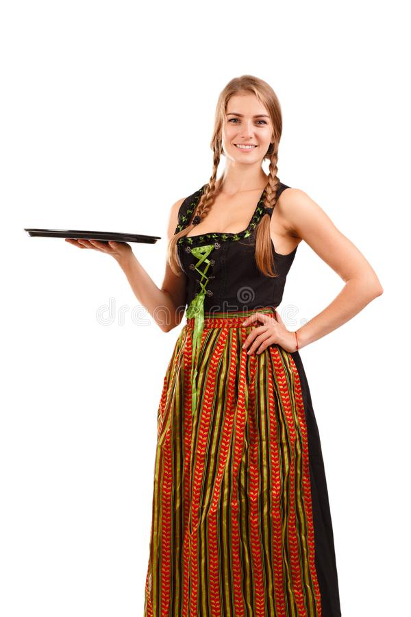 Woman in traditional bavarian dress. Isolated on white. German or Bavarian waitress with her hair in pigtails wearing a traditional dirndl. Oktoberfest concept stock images