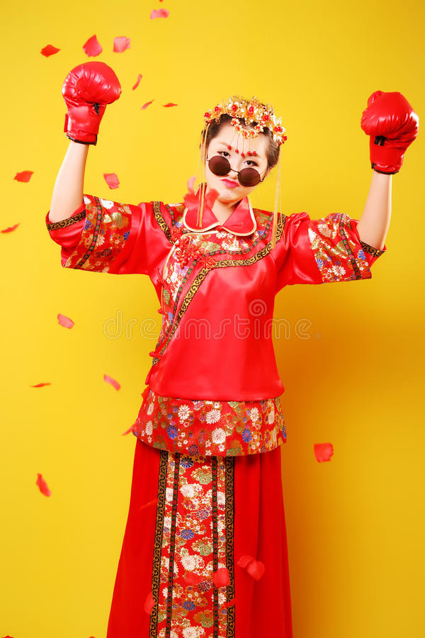 Woman in traditional Chinese costume and boxing gloves royalty free stock photos