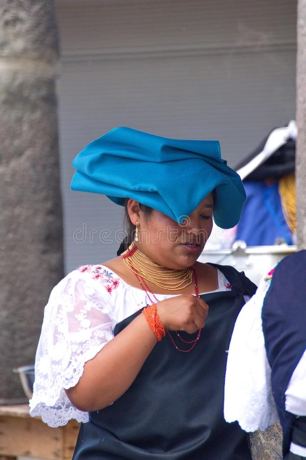 Indigenous person in the park in Cotacachi. Woman in traditional dress in the park on Day of the Dead in Cotacachi, Ecuador royalty free stock photos