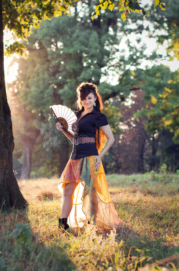 Woman with traditional fan stock images