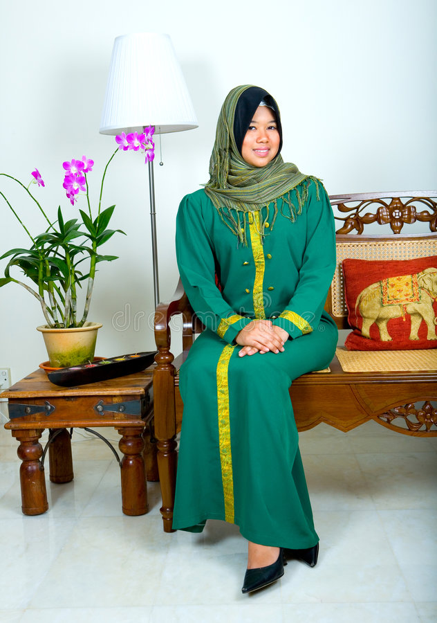 Woman in traditional Muslim clothing stock photos