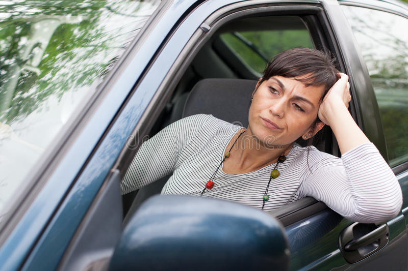 Woman in traffic congestion. Darkhair woman in traffic congestion royalty free stock image
