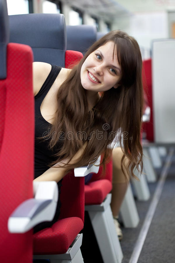 Woman is in the train. A smiling woman is in the train stock image