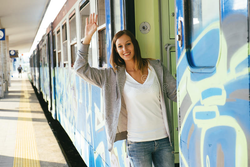 Woman train station stock photography