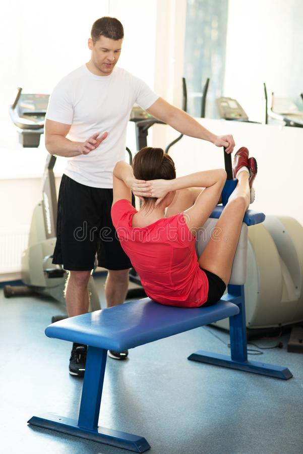 Woman with trainer in fitness club royalty free stock photos