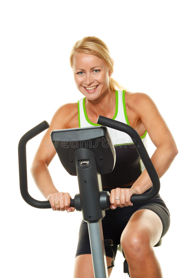 Woman in training for endurance. A young woman in training for endurance on the ergometer royalty free stock image