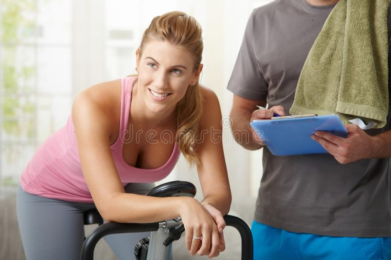 Download Woman Training On Exercise Bike Stock Image - Image: 12048063
